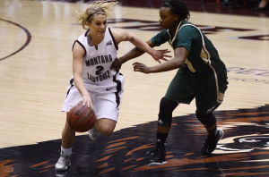 Samuel Wilson/ Montana KaiminUniversity of Montana forward Torry Hill (2) fights her way past the half court line Friday, March 15, 2013 in Dahlberg Arena. UM beat Sacramento State 74-53.