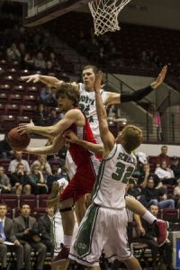 Thom Bridge/Montana KaiminUND's Mitch Wilmer(22) and Josh Schuler(32) defend SUU's Damon Heuir (3) March 14, 2013 at Dahlberg Arena. UND defeated SUU 69-52